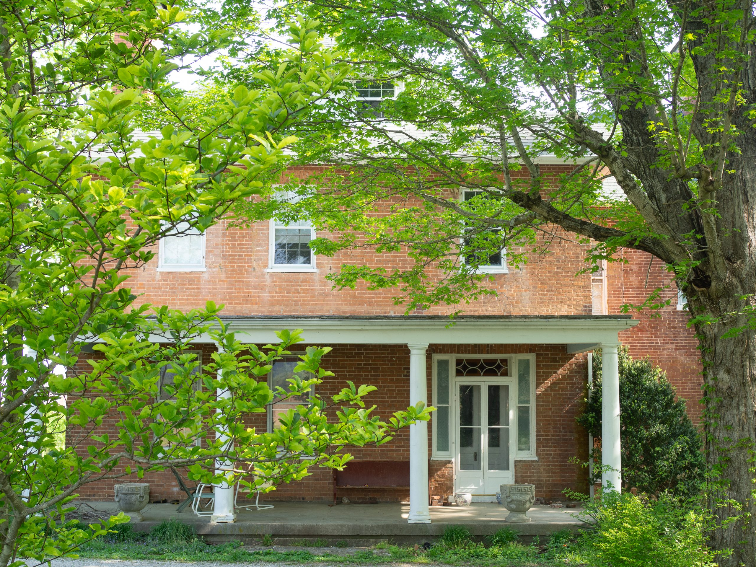 Red brick house with porch colonnades