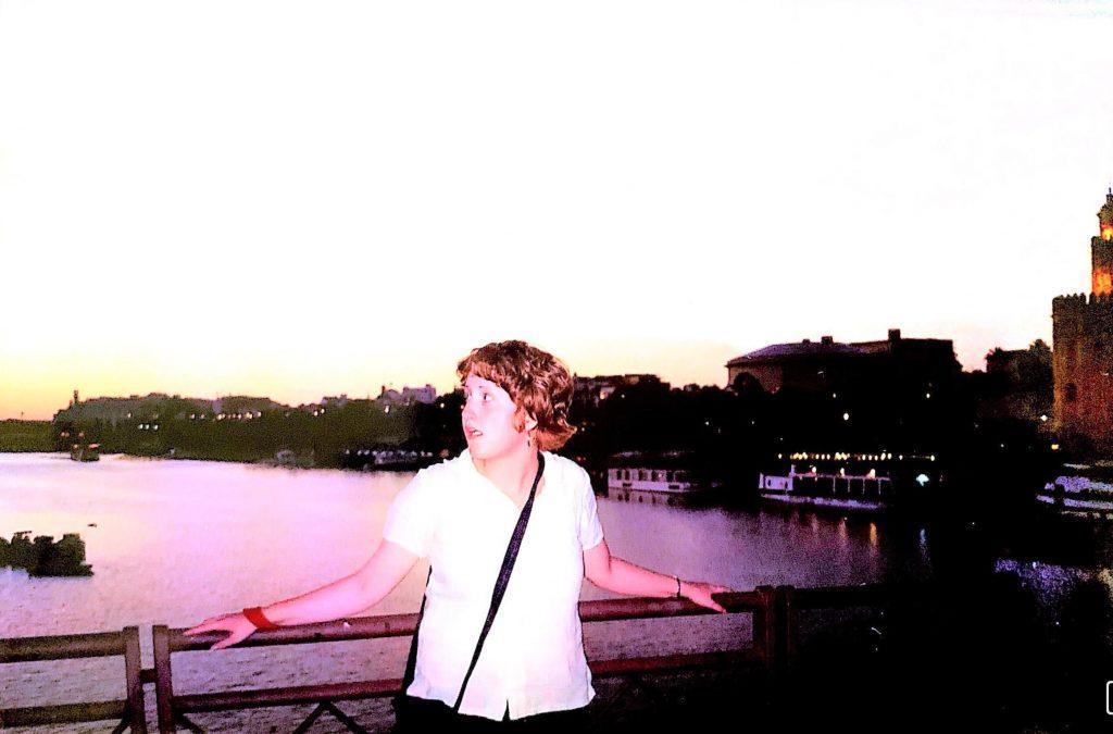 girl standing on a bridge over river in Seville