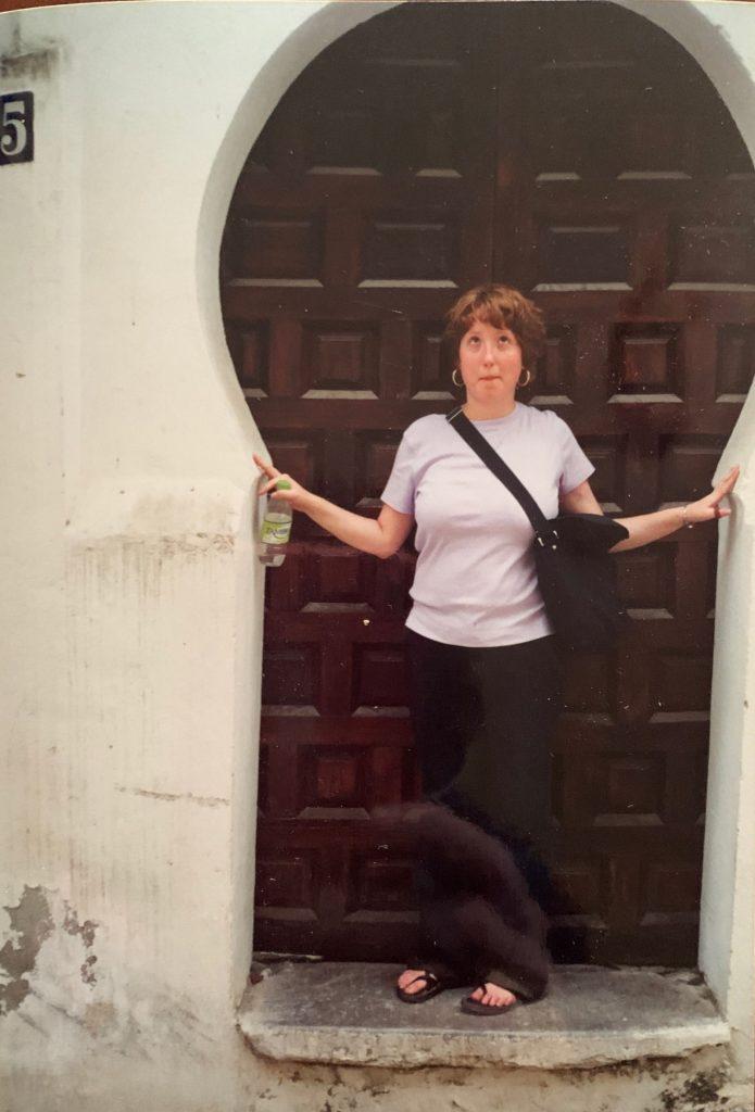 girl standing in keyhole shaped doorway