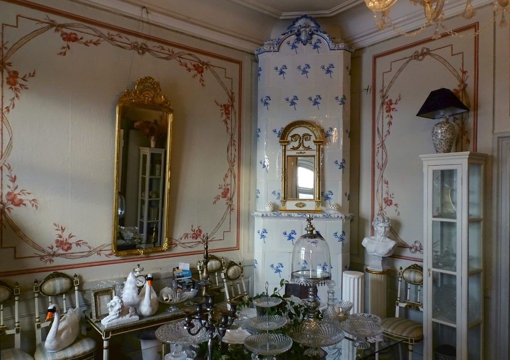 painted murals, blue tile stove