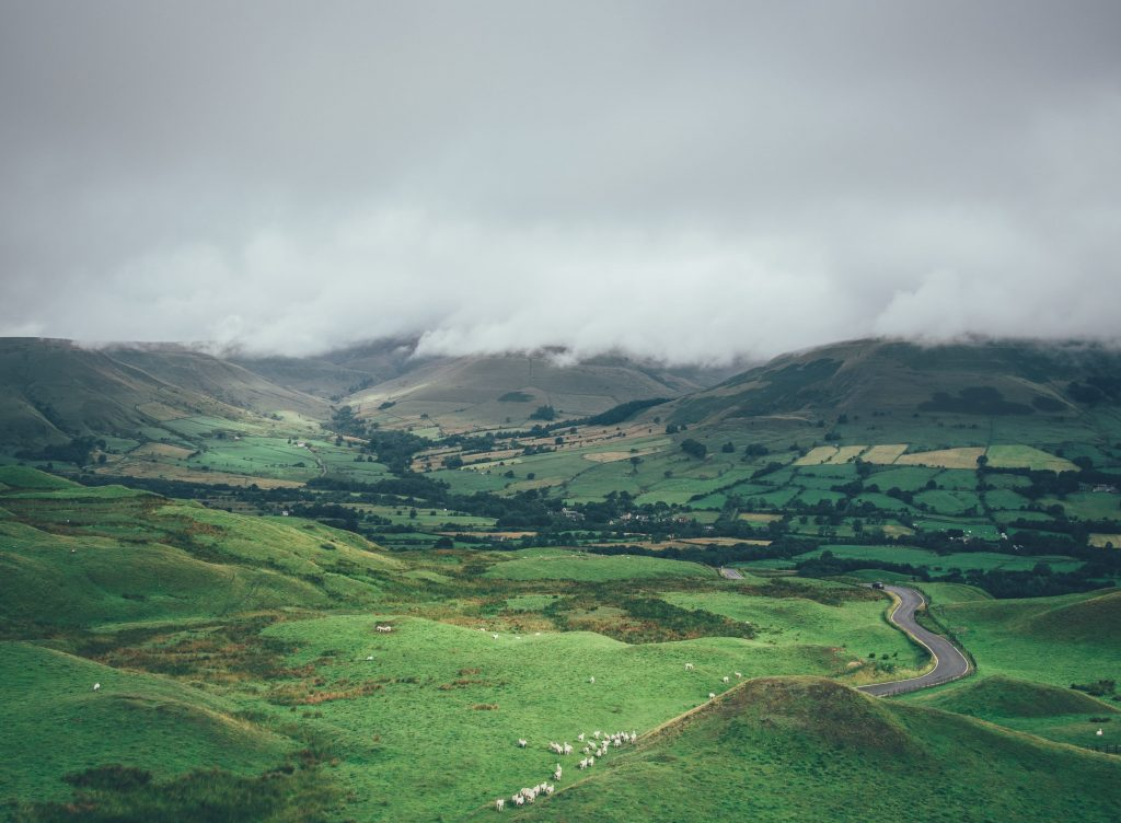 grey clouds, green valley