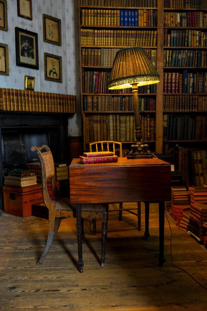 table, chair, lamp, books