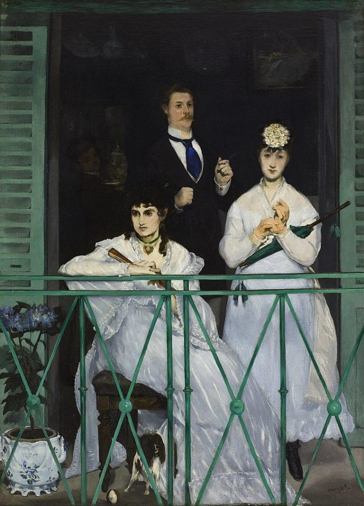 three people on balcony